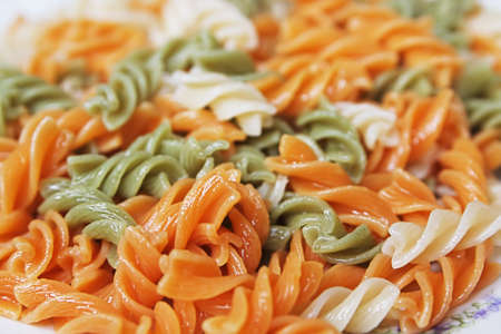 plateful: Plateful of cooked colored macaroni as background
