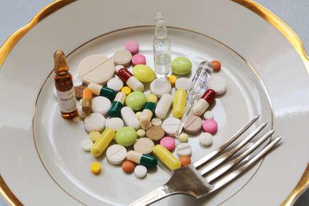 Medicine on dinner plate Stock Photo - 19297224