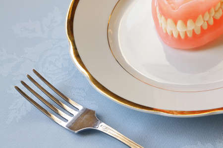 False teeth on  china ware with golden edging photo