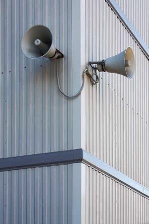 speaking trumpet: Public loudspeaker at the corner of the office block Stock Photo