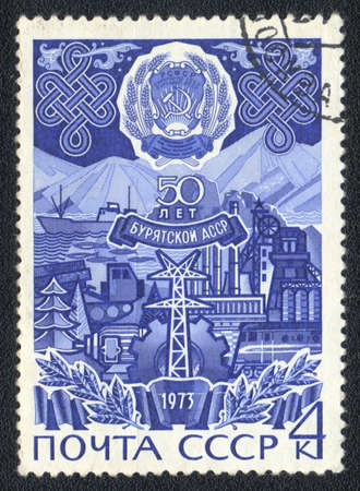 USSR - CIRCA 1973: A stamp printed in USSR  shows Advances in Buryatia, 50 years of Buryat Republic, circa 1973 photo