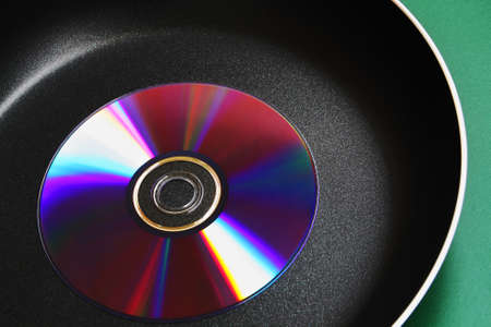 compact disk: Compact disk on a hot pan Stock Photo