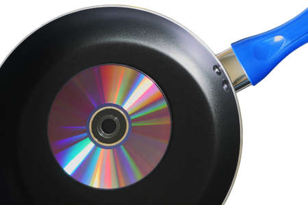 compact disk: Compact disk on a frying pan isolated on white background Stock Photo