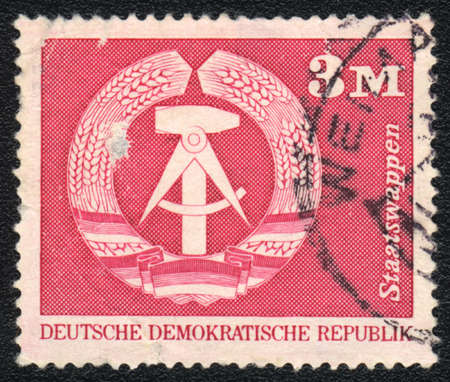 german mark: DDR - CIRCA 1975: A stamp printed in DDR  shows shows Emblem of the DDR, circa 1975