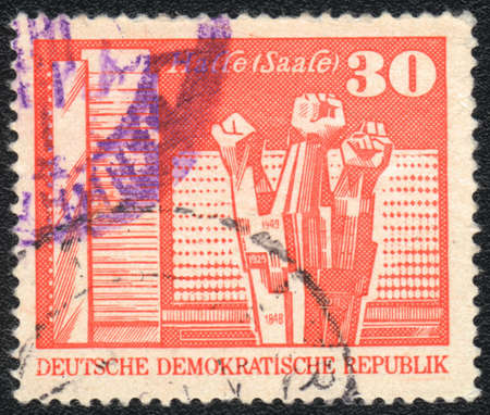 ddr: DDR - CIRCA 1973: A stamp printed in DDR  shows  Workers Memorial, Halle, circa 1973