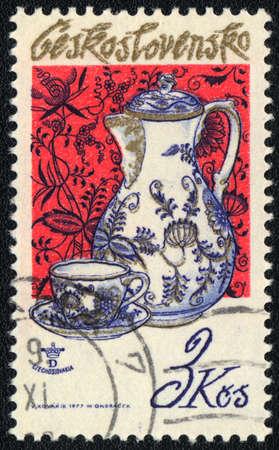 czechoslovakia: CZECHOSLOVAKIA - CIRCA 1977: A stamp printed in CZECHOSLOVAKIA  shows Jug and teacup, circa 1977
