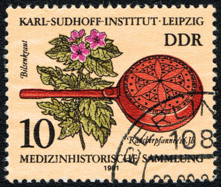 ddr: DDR - CIRCA 1981: A stamp printed in DDR  shows shows Henbane and  Historic medical instrument, Karl- Sudhoff- Institute, Leipzig , circa 1981