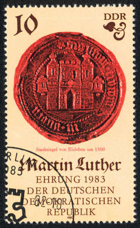 ddr: DDR - CIRCA 1982: A stamp printed in DDR  shows City seal of Eisleben, circa 1982 Editorial