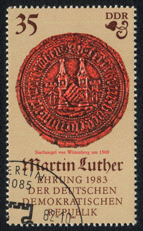 ddr: DDR - CIRCA 1982: A stamp printed in DDR  shows City seal of Wittenberg, circa 1982