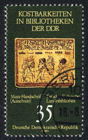 ddr: DDR - CIRCA 1981: A stamp printed in DDR  shows Maya handwriting, circa 1981 Editorial