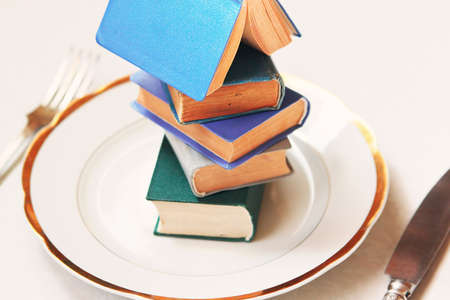 Pile of books as conceptual food