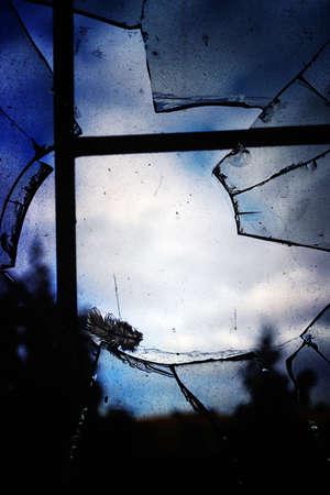 Dirty broken window with bars
