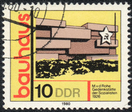 ddr: DDR- CIRCA 1980: A stamp printed in DDR  shows Memorial of Socialists, Bauhaus school, circa 1980  Editorial