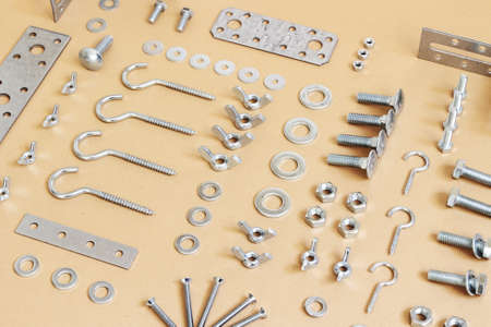 A wide variety of fasteners, spread on paper photo