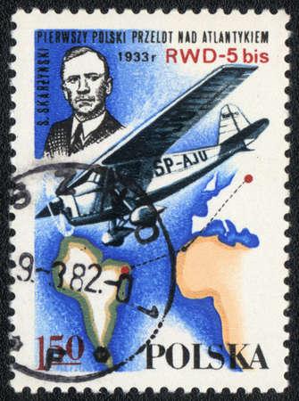 POLAND - CIRCA 1982: A postage stamp printed in Poland shows airplane SP-AJU and pilot of S.Skarzinski. First polish flight above Atlantica, circa 1982
