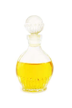 Old bottle of perfum isolated on white background photo