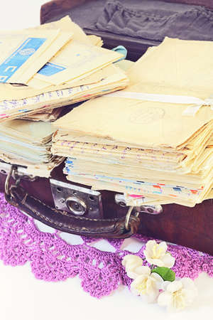 bundle of letters: Pile of old personal letters in  retro suitcase Stock Photo