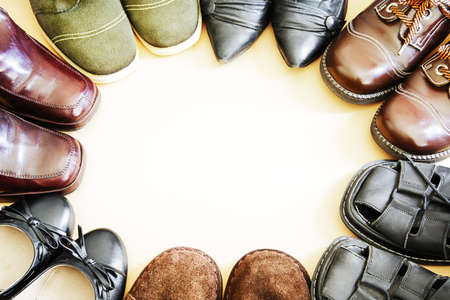 footgear: Circle of old shoes Stock Photo