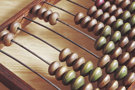 toned: Old wooden abacus. Image toned