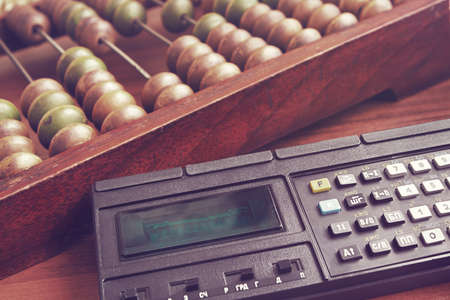 handheld computer: Old wooden abacus and obsolete mathematic  calculator