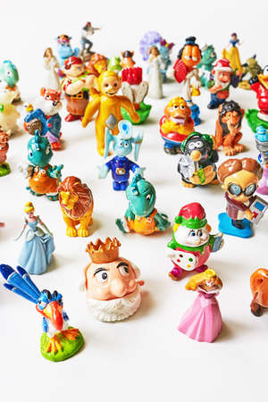 ST. PETERSBURG, RUSSIA -   March 13, 2016: Collection of small toys and toys of the Kinder Surprise.