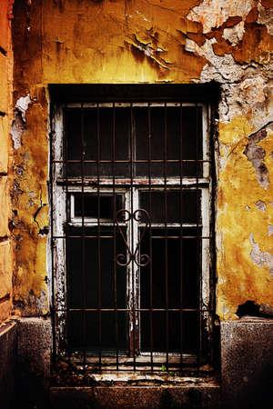 window bars: Old window with the metallic bars