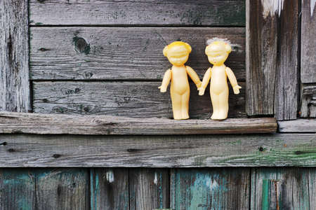 the ussr: Two old dolls standing on the wooden board.  Mass production made in USSR, 1970-1980.