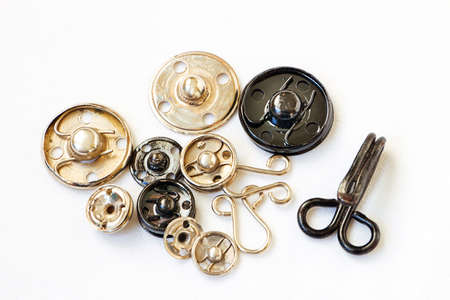 metal fastener: Vintage snap buttons and a great hook on textile background