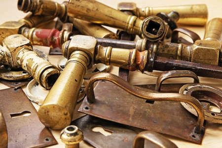 Bronze doorhandles and other metal parts of vintage furnitures