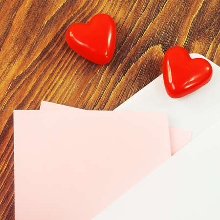 Opened envelope with the red heart and a pink paper for your text