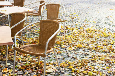 Empty open-air cafe in the autumn and text space
