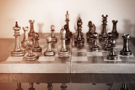 Chess game. Old wooden chess set on a polished table