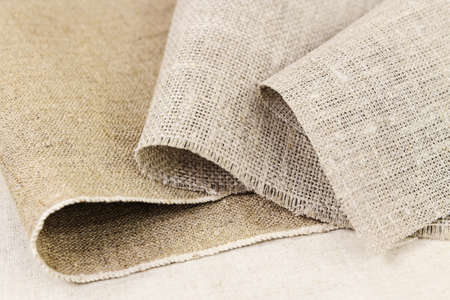 Folds of gray cotton and flax canvas Stock Photo