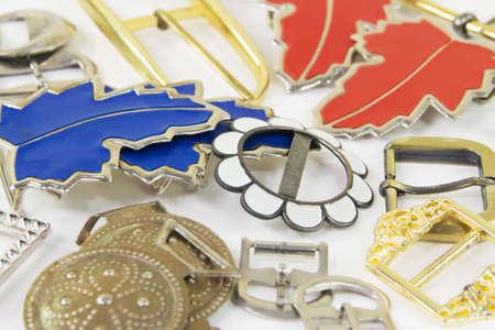 Metal buckles of various design for clothes and footwear closeup