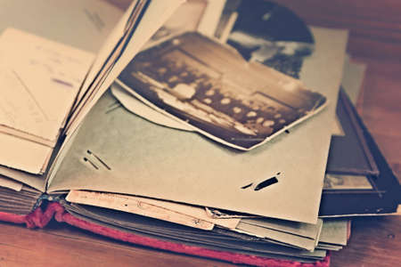Pages of vintage photograph album with old photos
