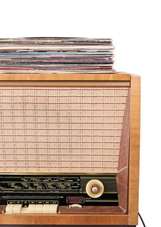 Pile of the vinyl records on the vintage radio receiver - player isolated on white 免版税图像