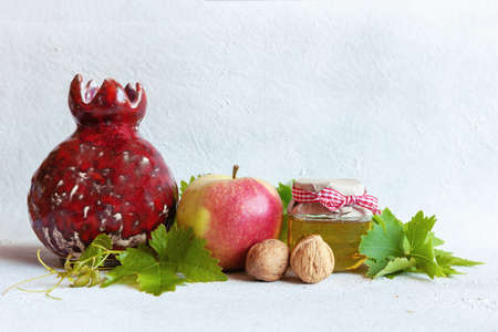 Apples and honey. Concept for Rosh Hashanah the Jewish New Year. Top view, close up on white background.