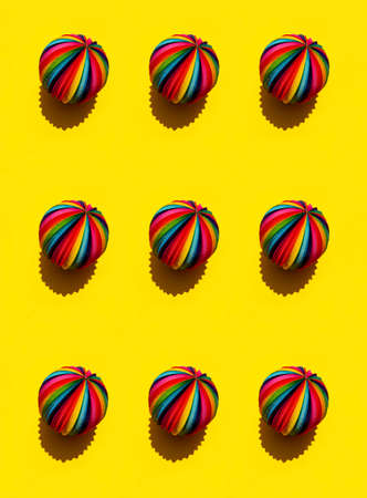 Geometric pattern of Rainbow Sphere on a bright yellow background, top view Stock Photo