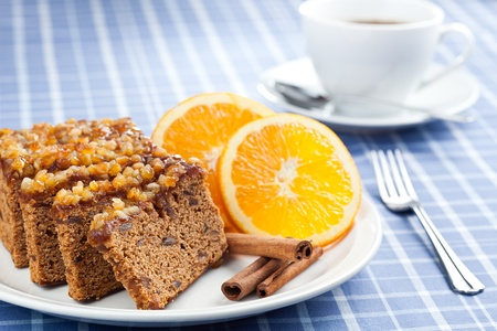 Gingerbread with orange and cup of coffee or tea.  photo