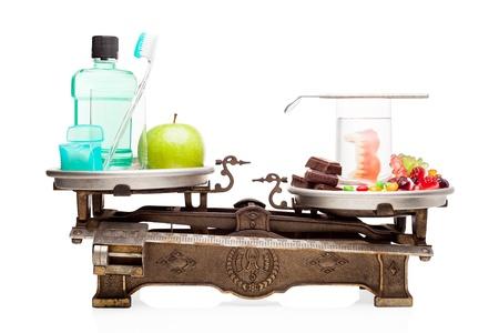 Cure dentistiche versus la dieta malsana. Archivio Fotografico