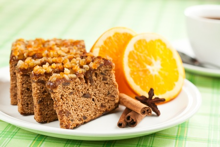 Gingerbread with orange and cup of coffee or tea.