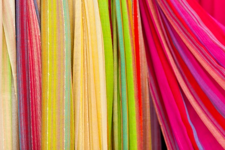 cotton dress: Closeup of colorful scarves. Shallow deep of focus. Stock Photo