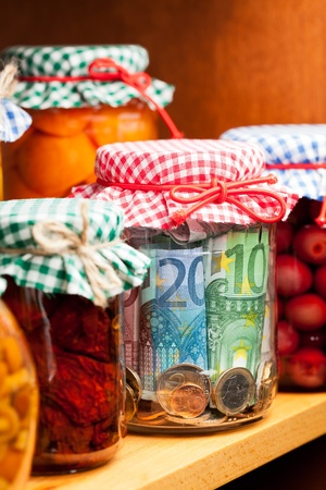 Financial reserves. Money conserved in a glass jar. Standard-Bild