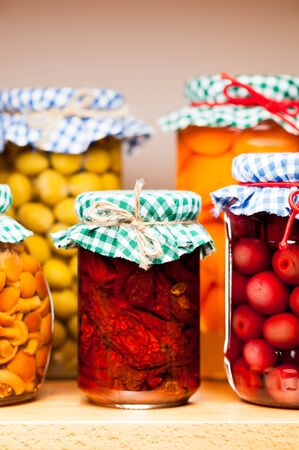country kitchen: Preserved fruits and vegetables  Stock Photo