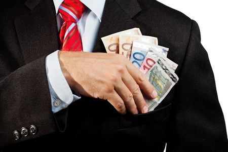 corrupt: Businessman putting money in his pocket
