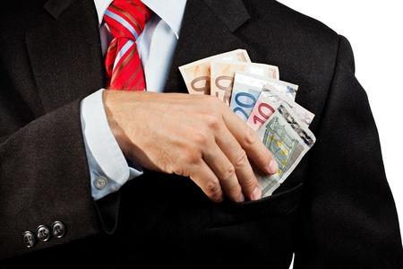corrupcion: Empresario poner dinero en el bolsillo
