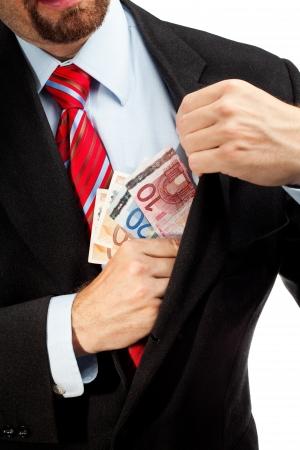 Businessman putting money in his pocket  photo