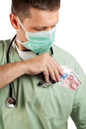 bribe: Doctor with stethoscope placing money in his pocket. Stock Photo