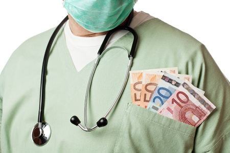 Doctor with money in his pocket. photo