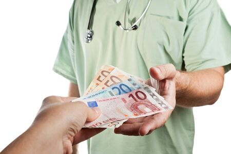 fees: Patient paying to the doctor   Stock Photo